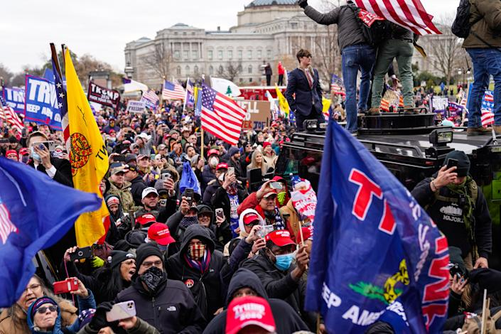 """Crowds gather outside the U.S. Capitol for the """"Stop the Steal"""" rally on January 06, 2021 in Washington, DC. (Photo by Robert Nickelsberg/Getty Images)"""