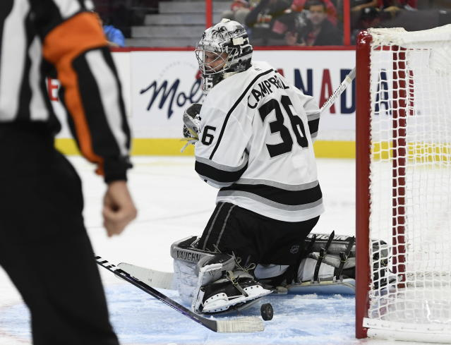 The stick of Los Angeles Kings left wing Ilya Kovalchuk (not shown) redirects the puck from behind Los Angeles Kings goaltender Jack Campbell (36) who searches for it during second-period NHL hockey game action in Ottawa, Ontario, Thursday, Nov. 7, 2019. (Justin Tang/The Canadian Press via AP)