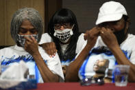 Family members of Byron Williams, from left, sister Cheryl Lewis, niece Marcia Wells and sister Gwendolyn Lewis comfort each other during a news conference, Thursday, July 15, 2021, in Las Vegas. The family of 50-year-old Byron Williams, whose death in Las Vegas police custody after a bicycle chase in 2019 was ruled a homicide, is suing the city and four officers they accuse of wrongful death and civil rights violations. (AP Photo/John Locher)