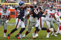 Chicago Bears outside linebacker Khalil Mack (52) forces a fumble by New York Giants quarterback Daniel Jones (8) during the second half of an NFL football game in Chicago, Sunday, Nov. 24, 2019. (AP Photo/Charles Rex Arbogast)