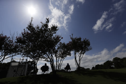 Scorekeepers wait for golfers on the seventh hole during the first round of the World Golf Championship-FedEx St. Jude Invitational Thursday, July 30, 2020, in Memphis, Tenn. (AP Photo/Mark Humphrey)