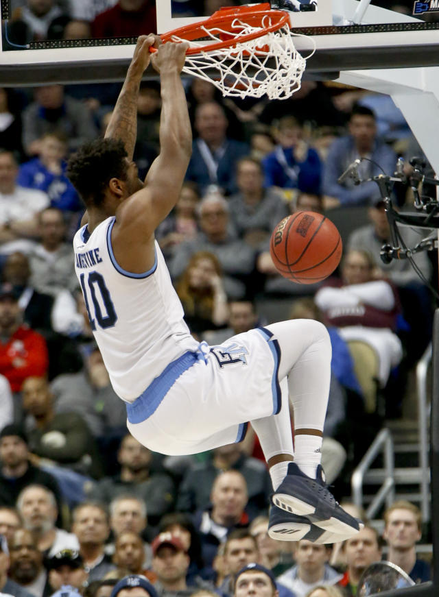 Rhode Island's Cyril Langevine (10) dunks against Oklahoma during the second half of an NCAA men's college basketball tournament first-round game, Thursday, March 15, 2018, in Pittsburgh. Rhode Island won 83-78 in overtime to advance to the second round. (AP Photo/Keith Srakocic)