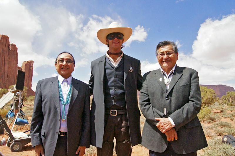 "This April 2012 photo released by the Navajo Nation shows, Navajo Nation Vice President Rex Lee Jim, left, with Armie Hammer and Navajo Nation President Ben Shelly in Monument Valley during the filming of ""The Lone Ranger."" (AP Photo/Emerald Craig, Navajo Nation)"