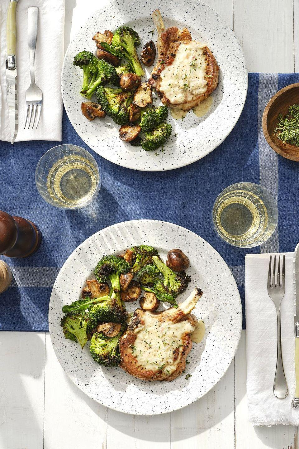 """<p>You can roast a duo of broccoli and mushroom florets perfectly together in the oven. With an easy sautéed pork chop, dinner is ready in under an hour.</p><p><em><a href=""""https://www.countryliving.com/food-drinks/a30418573/smothered-pork-chops-recipe/"""" rel=""""nofollow noopener"""" target=""""_blank"""" data-ylk=""""slk:Get the recipe for Country Living »"""" class=""""link rapid-noclick-resp"""">Get the recipe for Country Living »</a></em> </p>"""