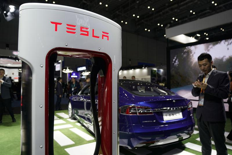 FILE PHOTO - A Tesla sign is seen during the China International Import Expo (CIIE), at the National Exhibition and Convention Center in Shanghai