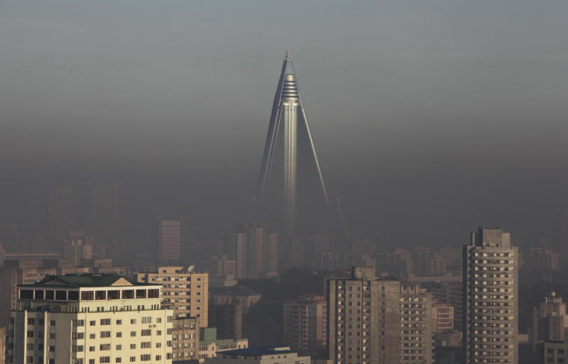 FILE - In this Oct. 26, 2011 file photo, the 105-storey Ryugyong Hotel stands above others in Pyongyang, North Korea. International hotel operator Kempinski AG said Thursday, Nov. 1, 2012 it will manage the pyramid-shaped hotel that is expected to open next year with shops, offices, ball rooms and restaurants and 150 rooms. (AP Photo/Greg Baker, File)