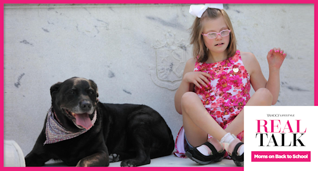 Hallie Levine's daughter Jo Jo, who has special needs, and the family dog. (Photo: Fatima Barroso)