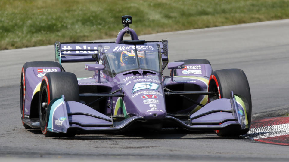 FILE - Romain Grosjean competes during an IndyCar race at Mid-Ohio Sports Car Course in Lexington, Ohio, in this Sunday, July 4, 2021, file photo. Former Formula One driver Romain Grosjean, who moved to IndyCar this year but said he'd only race the road and street courses, has fallen in love with the series and relented on his opposition to ovals. (AP Photo/Tom E. Puskar, File)