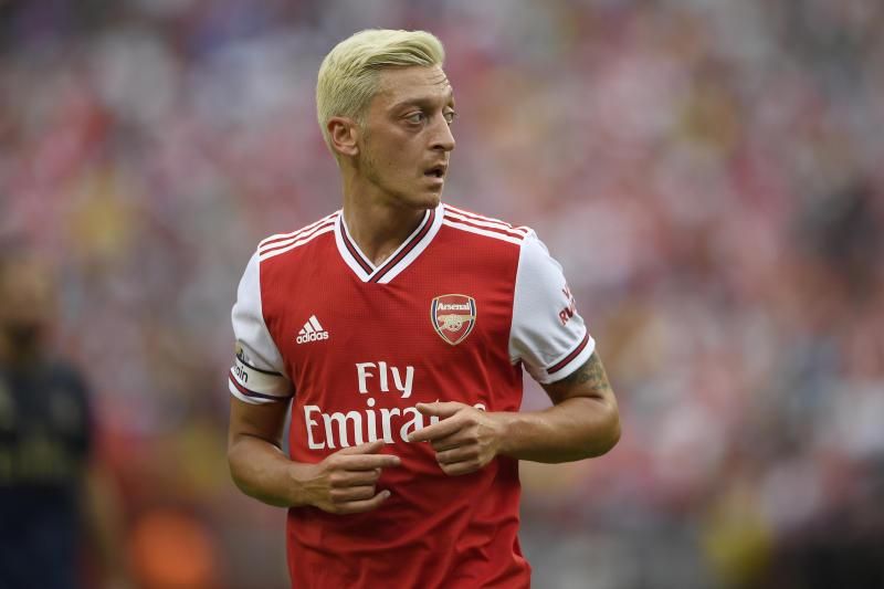 Arsenal midfielder Mesut Ozil stands on the field during the first half of an International Champions Cup soccer match against Real Madrid, Tuesday, July 23, 2019, in Landover, Md. (AP Photo/Nick Wass)