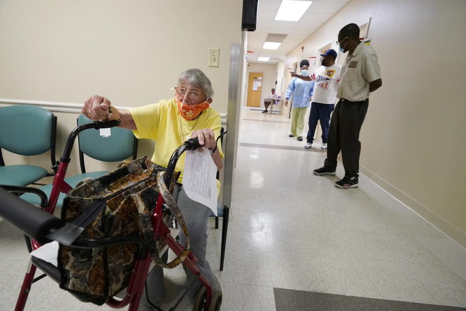 Linda Busby, 74, waits to receive her Johnson & Johnson COVID-19 vaccine at the Aaron E. Henry Community Health Service Center, Wednesday, April 7, 2021, in Clarksdale, Miss. Busby joined a group of seniors from the Rev. S.L.A. Jones Activity Center for the Elderly that were given a ride to the health center for their vaccinations. The Mississippi Department of Human Services is in the initial stages of teaming up with community senior services statewide to help older residents get vaccinated. (AP Photo/Rogelio V. Solis)