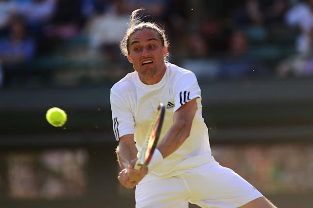 LONDON, ENGLAND - JUNE 29: Alexandr Dolgopolov of Ukraine hits a backhand during the Gentlemen's Singles third round match against David Ferrer of Spain on day six of the Wimbledon Lawn Tennis Championships at the All England Lawn Tennis and Croquet Club on June 29, 2013 in London, England. (Photo by Mike Hewitt/Getty Images)