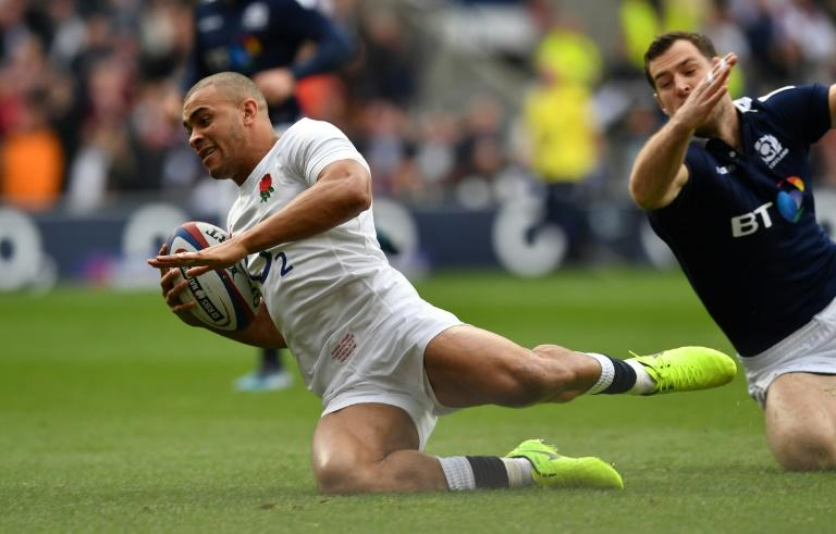England's centre Jonathan Joseph scores his team's first try during their Six Nations international rugby union match against Scotland at Twickenham stadium in south west London on March 11, 2017