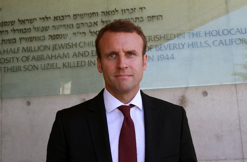 French Economy and Industry minister Emmanuel Macron leaves after signing the guest book during his visit at the Yad Vashem Holocaust Memorial museum in Jerusalem, September 6, 2015