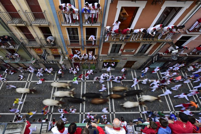 Revellers run next to fighting bulls during the running of the bulls at the San Fermin Festival, in Pamplona, northern Spain, Friday, July 12, 2019. (Photo: Alvaro Barrientos/AP)