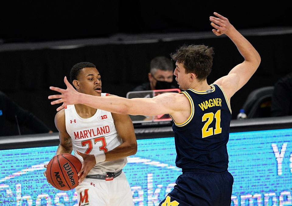 Maryland guard Aquan Smart tries to pass as he is defended by Michigan guard Franz Wagner during the first half Thursday, Dec. 31, 2020, in College Park, Md.