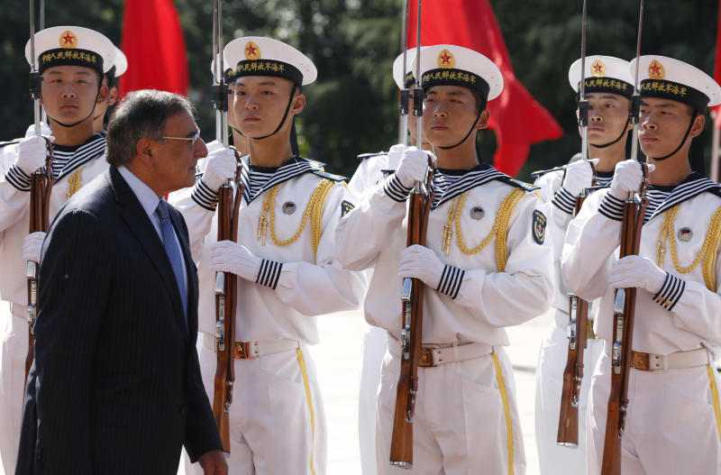 U.S. Defense Secretary Leon Panetta reviews Chinese military troops with China's Defense Minister Liang Guanglie, not seen, at the Bayi Building in Beijing, China Tuesday, Sept. 18, 2012. (AP Photo/Larry Downing, Pool)
