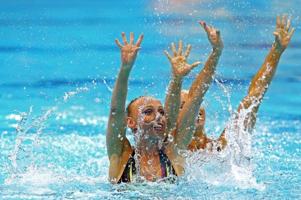 LONDON, ENGLAND - AUGUST 05:  Plancarte Delgado and Nuria Diosdado of Mexico compete in the Women's Duets Synchronised Swimming Technical Routine on Day 9 of the London 2012 Olympic Games at the Aquatics Centre  on August 5, 2012 in London, England.  (Photo by Clive Rose/Getty Images)