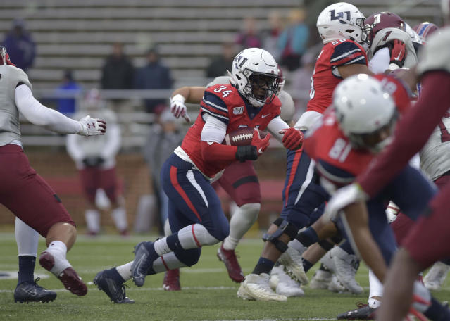 Liberty running back Joshua Mack carries the ball during an NCAA college football game against New Mexico State in Lynchburg, Va., on Saturday, Nov. 30, 2019. (Taylor Irby/ News & Advance via AP)