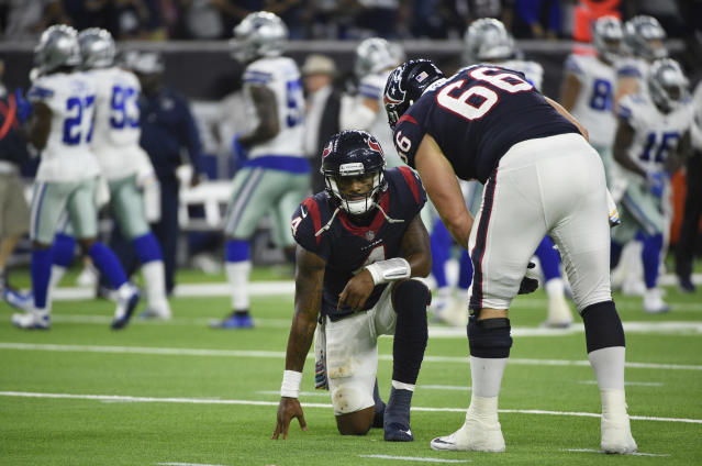 FILE - In this Oct. 7, 2018, file photo, Houston Texans center Nick Martin (66) checks on quarterback Deshaun Watson (4) during the second half of an NFL football game against the Dallas Cowboys, in Houston. Everyone agrees that Deshaun Watson took far too many hits last week against the Dallas Cowboys. That doesn't mean Houston's quarterback is going to change the way he plays on Sunday when the Texans (2-3) host the Buffalo Bills (2-3).(AP Photo/Eric Christian Smith, File)