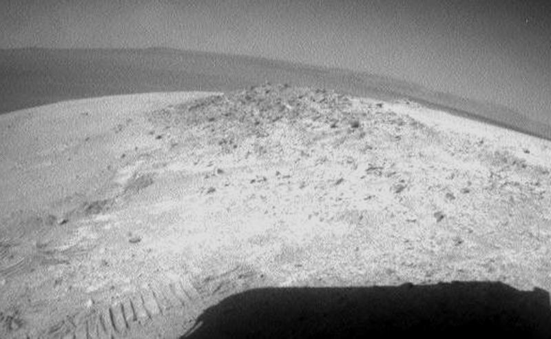 This undated image provided by NASA shows the Mars rover Opportunity looking back at an outcrop where it spent the Martian winter. Opportunity started driving again this week after spending 19 weeks in one spot conducting science experiments, Tuesday, May 8, 2012. (AP Photo/NASA)