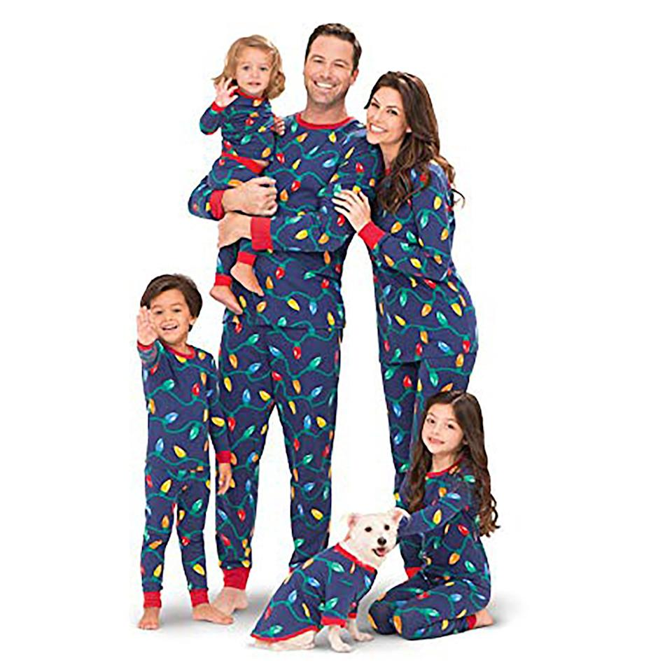 """<p>Snap the perfect photo on Christmas morning with this colorful cotton set of pajamas. The soft jersey PJs feature colorful string lights and come in sizes for the whole family, including the dog.</p> <p><strong>To buy:</strong> From $15; <a href=""""https://www.amazon.com/PajamaGram-Matching-Christmas-Pajamas-Family/dp/B00Q5PU7ZC/ref=as_li_ss_tl?ie=UTF8&linkCode=ll1&tag=rslifefamilychristmaspajamasccalucchia0919-20&linkId=2bd47c47ac526f62e29f1716736feb15"""" target=""""_blank"""">amazon.com</a>.</p>"""
