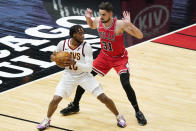 Cleveland Cavaliers guard Darius Garland, left, looks to pass as Chicago Bulls guard Tomas Satoransky guards during the first half of an NBA basketball game in Chicago, Wednesday, March 24, 2021. (AP Photo/Nam Y. Huh)