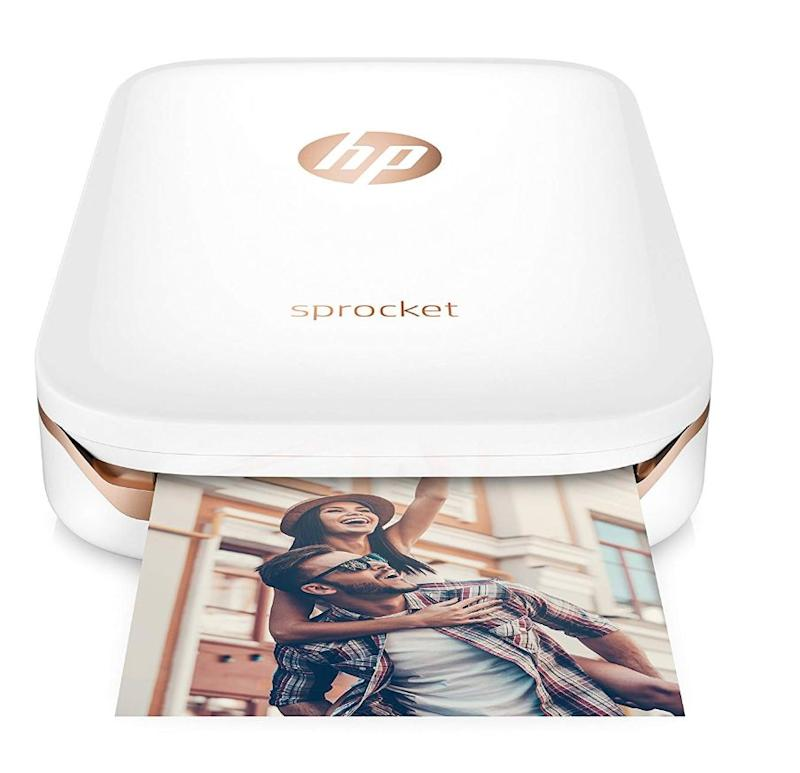 """If your entire phone's storage isn't photos of your kids, are you even a parent? Print some of those memories with this easy portable photo printer from <a href=""""https://www.amazon.ca/dp/B01LBWEMP4/ref=cm_gf_aAN_i18_d_p0_c0_qd2___________________GXXDoI0cdJHqRjTylhdL"""" target=""""_blank"""" rel=""""noopener noreferrer"""">Amazon</a>, $144.99."""
