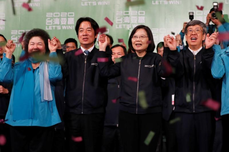 Presidential Office Secretary-General Chen Chu, Vice President-elect William Lai, incumbent Taiwan President Tsai Ing-wen and incumbent Vice President Chen Chien-jen celebrate at a rally after their election victory in Taipei