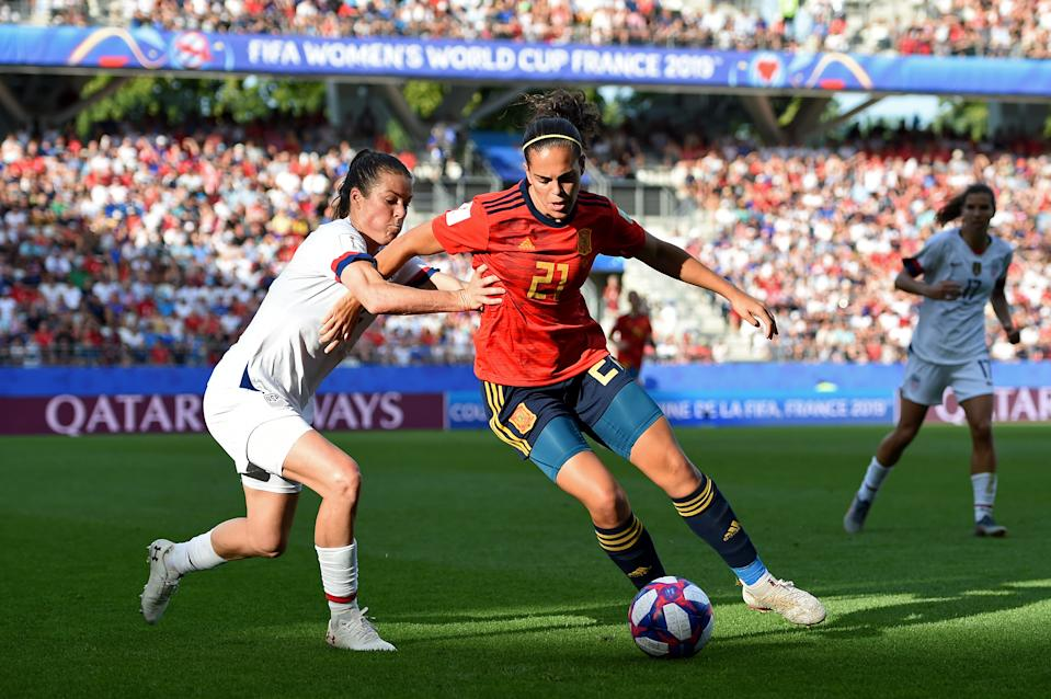Andrea Falcon of Spain is challenged by Kelley O'hara of the USA during the 2019 FIFA Women's World Cup France Round Of 16 match between Spain and USA at Stade Auguste Delaune on June 24, 2019 in Reims, France. (Photo by Alex Caparros - FIFA/FIFA via Getty Images)