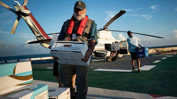 PHOTO: Chef Jose Andres carries food relief while working with his charity group World Central Kitchen to help survivors of Hurricane Dorian Sept. 5, 2019, in Marsh Harbor, Great Abaco, Bahamas. (Brendan Smialowski/AFP/Getty Images)