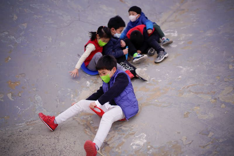 Children wearing face masks play at a park, as the country is hit by an outbreak of the novel coronavirus, in Shanghai