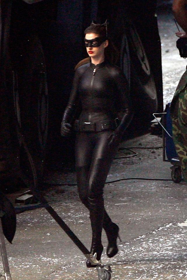 """CATWOMAN<br><a href=""""http://movies.yahoo.com/movie/the-dark-knight-rises/"""">""""The Dark Knight Rises""""</a><br>Grade: A<br>Anne Hathaway has proclaimed how difficult the cat suit was to wear, but this is a case where the pain was worth it -- for audiences, at least. From the ears to the eye-mask to the thigh-high platform boots, this Catwoman is tres chic!"""