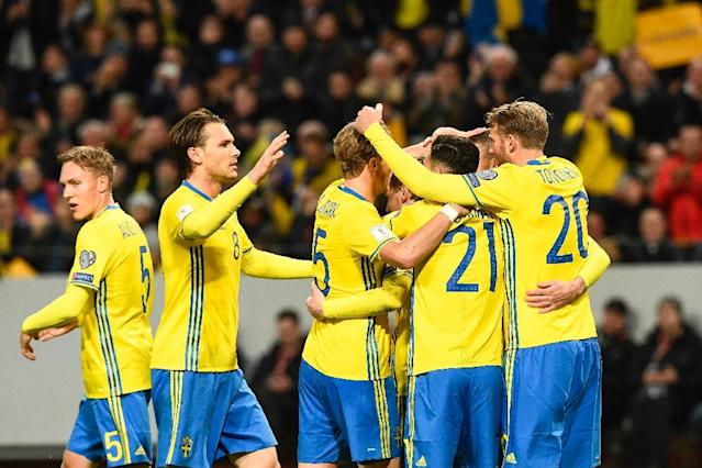 Sweden's midfielder Emil Forsberg celebrates with his teammates after scoring during their FIFA World Cup 2018 qualifier against Belarus in Solna on March 25, 2017 (AFP Photo/Jonathan NACKSTRAND)