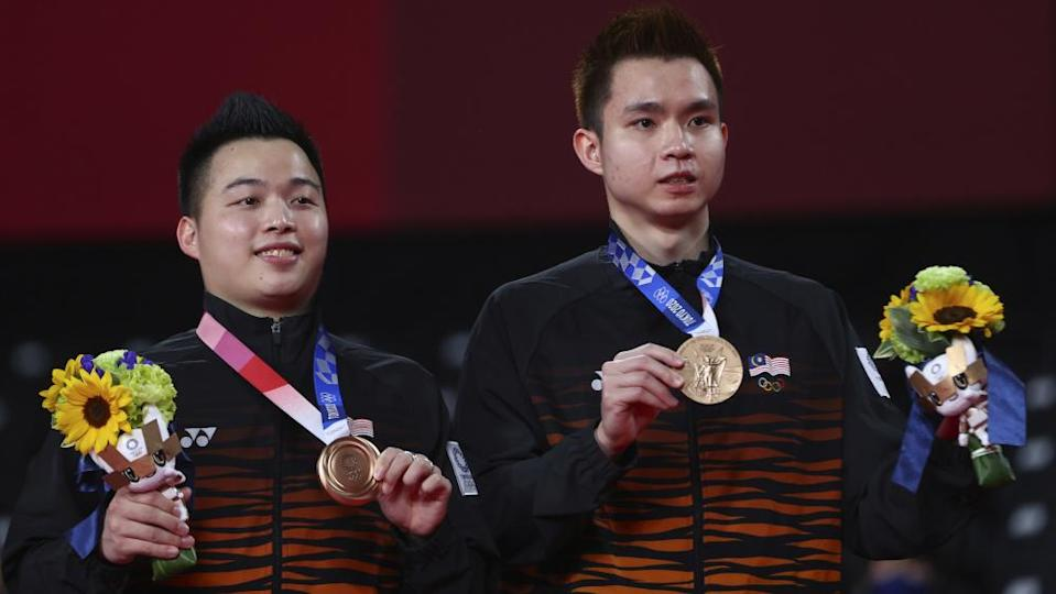Bronze medallists Malaysia's Aaron Chia and Soh Wooi Yik pose with their bronze medals after the Tokyo 2020 Olympics badminton Men's Doubles medal ceremony at Musashino Forest Sport Plaza, Tokyo July 31, 2021. — Reuters pic