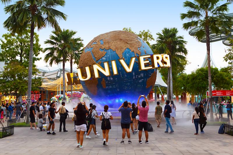 PHOTO: Getty Images)SINGAPORE-November 28, 2019: Tourists and theme park visitors taking pictures of the large globe in front of Universal Studios. Sentosa island