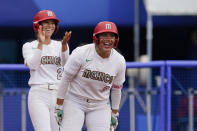 Mexico's Sydney Romero and Victoria Vidales celebrate during a softball game against Canada at the 2020 Summer Olympics, Tuesday, July 27, 2021, in Yokohama, Japan (AP Photo/Sue Ogrocki)