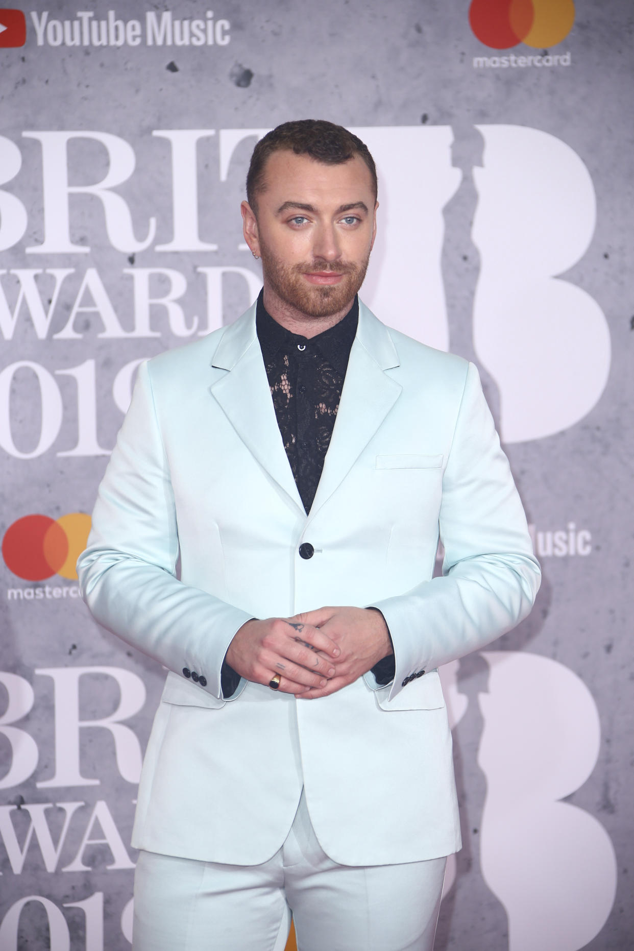 Singer Sam Smith poses for photographers upon arrival at the Brit Awards in London, Wednesday, Feb. 20, 2019. (Photo by Joel C Ryan/Invision/AP)