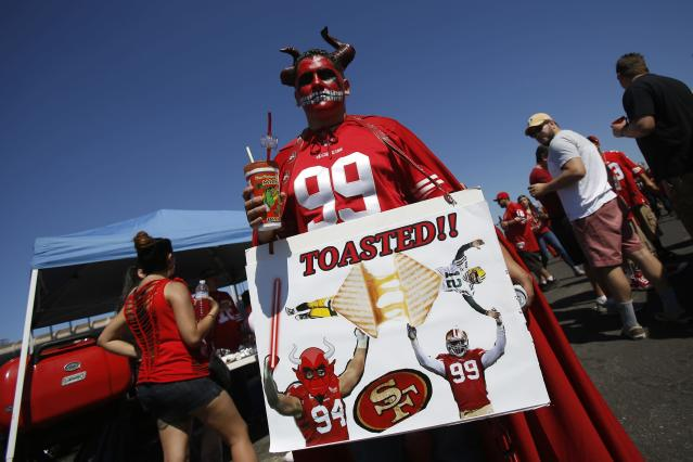A football fan holds a sign before the NFL football season home opener between the San Francisco 49ers and the Green Bay Packers in San Francisco, California September 8, 2013. REUTERS/Stephen Lam (UNITED STATES - Tags: SPORT FOOTBALL)