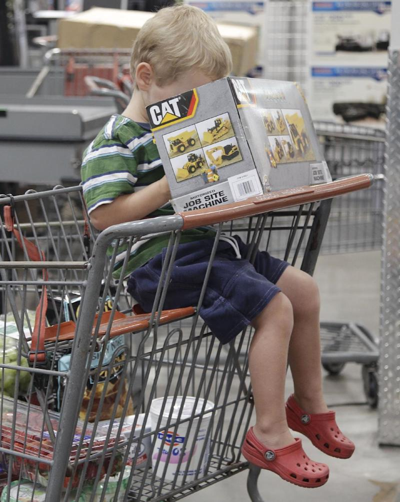 In this Aug. 26, 2011 photo, a young shopper peers into a box containing a CAT motorized job site machine, as he waits to get through the check-out at Costco in Mountain View, Calif. A private research group said Tuesday, Aug. 30, 1011, that consumers' confidence in the economy in August dropped almost 15 points to the lowest level since April 2009 as worries about the economy fueled the wildest stock market swings since the financial meltdown in 2008.  (AP Photo/Paul Sakuma)