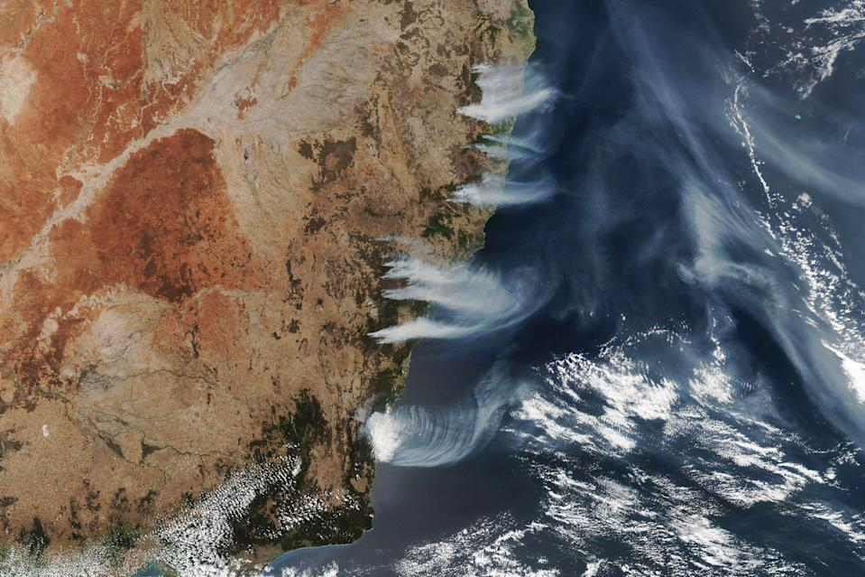 Wildfires have been raging across the southern and eastern states of Australia since October, and new imagery from the NOAA-NASA Suomi NPP weather satellite show plumes of smoke billowing from multiple fires near the coast of New South Wales. Another Suomi-NPP image captured in November show smoke from Australia's wildfires being swept across the South Atlantic Ocean, and that smoke has since spread to halfway around the world, NASA officials said in a statement. The satellite acquired this image on Wednesday (Dec. 4) at 2:45 p.m. local time, when there were 116 actively burning bush and grass fires in New South Wales alone.