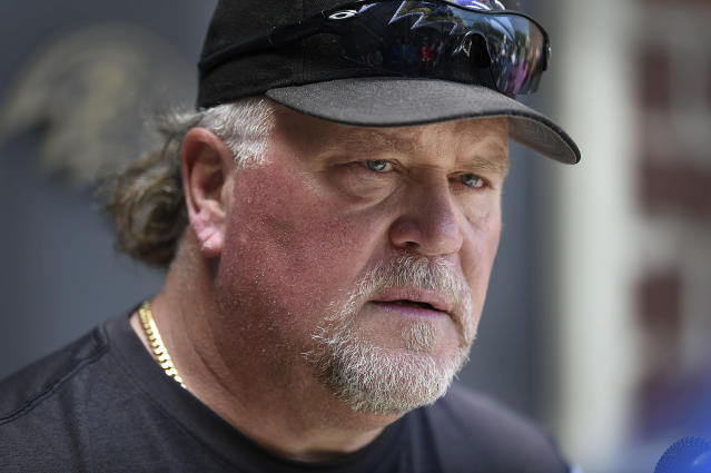 FILE - In this June 12, 2019, file photo, Baltimore Ravens defensive coordinator Don Martindale speaks with reporters at the NFL football team's training facility in Owings Mills, Md. The success of the Ravens has created an interest in coordinators Greg Roman and Don Martindale as potential candidates to fill NFL head coaching vacancies. (AP Photo/Gail Burton, File)