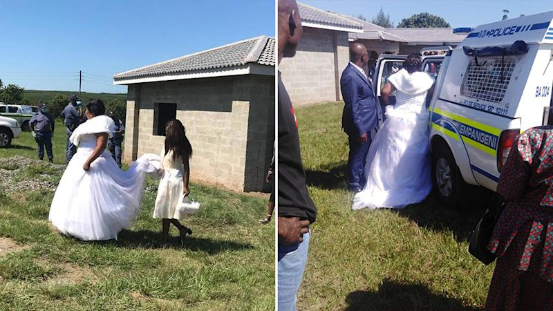 Picture of the bride, in her gown getting arrested