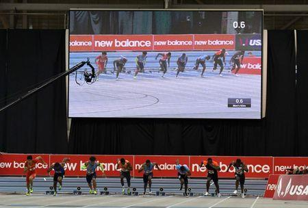 Feb 10, 2018; Boston, Massachussetts, USA; Christian Coleman (USA), fourth from right, wins the 60m in 6.46 during the New Balance Indoor Grand Prix at Reggie Lewis Center. From left: Xie Zhenye (CHN), Keston Bedman (TTO), Christopher Belcher (USA), Noah Lyles (USA), Coleman, Abullah Mohammed (RSA), Harry Aikines-Aryeetey (GBR) and Antoine Adams (STK). Mandatory Credit: Kirby Lee-USA TODAY Sports