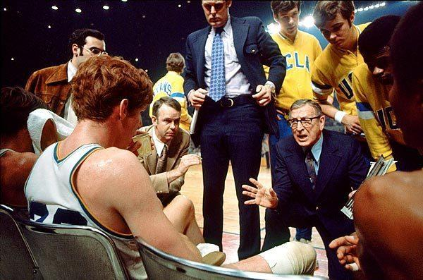 """John Wooden instructs his players, including Bill , seated left, during the 1972 NCAA final at the Sports Arena in Los Angeles. The Bruins beat Florida State, 81-76, for their sixth consecutive national championship. Walton had 24 points. <span class=""""copyright"""">(Rich Clarkson / Getty Images)</span>"""