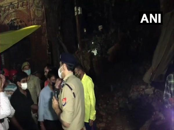 Rescue operation is underway at the building collapse site in Kanpur.