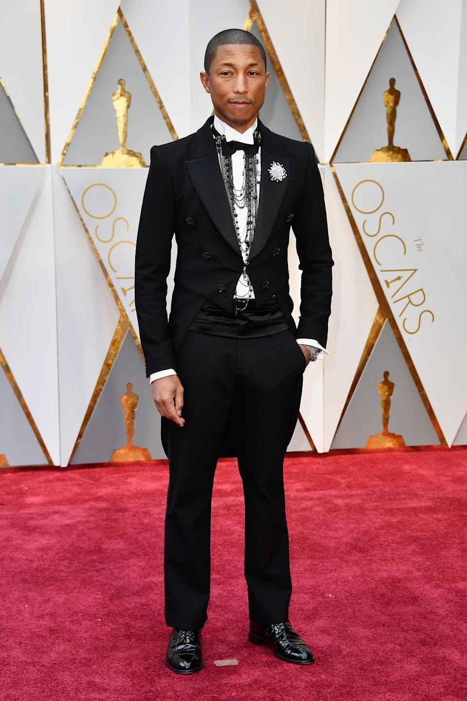 <p>Wearing a custom Chanel suit. [Photo: PA] </p>