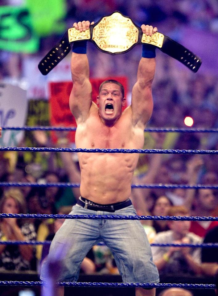 """15 minutes later, John Cena won the title by delivering his signature maneuver, the Attitude Adjustment, on both of his opponents. Bob Levey/<a href=""""http://www.wireimage.com"""" target=""""new"""">WireImage.com</a> - April 5, 2009"""
