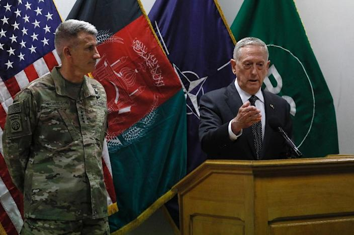 """US Defense Secretary James Mattis, pictured (R) with General John Nicholson, commander of US and NATO forces in Afghanistan, warned of """"another tough year"""" when he visited Kabul (AFP Photo/JONATHAN ERNST)"""