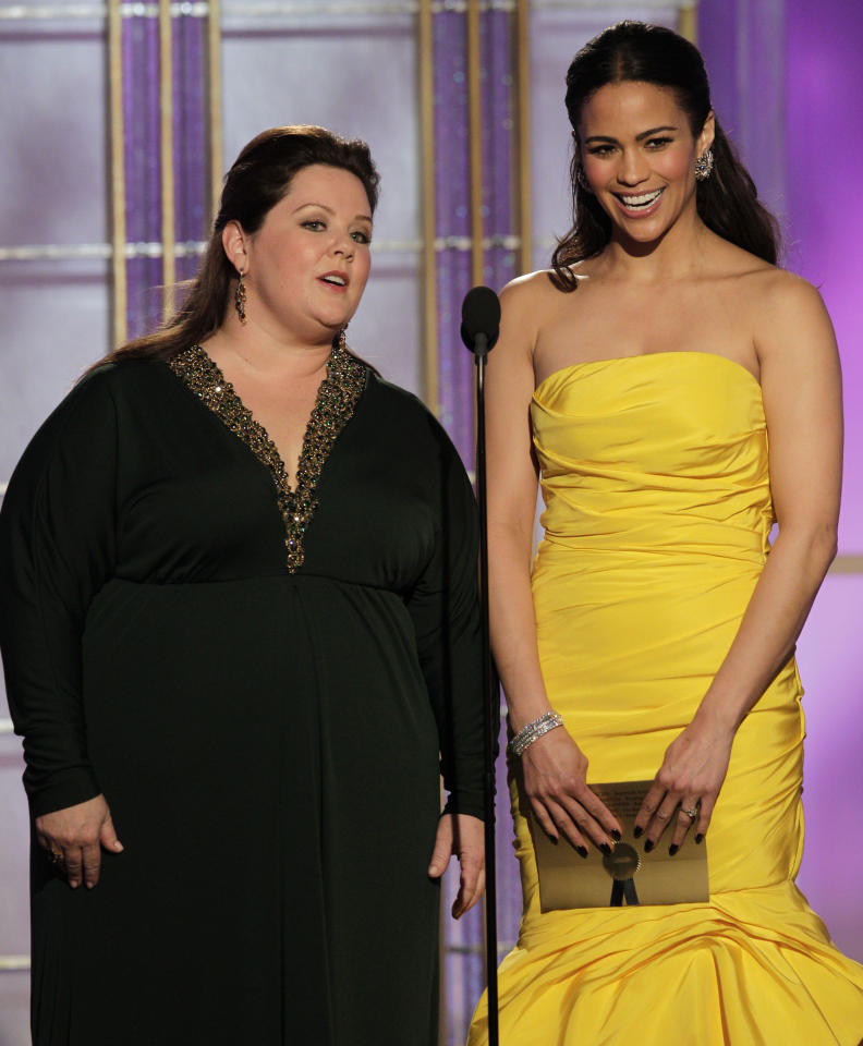 BEVERLY HILLS, CA - JANUARY 15: In this handout photo provided by NBC, actress Melissa McCarthy (L) and Paula Patton present an award onstage during the 69th Annual Golden Globe Awards at the Beverly Hilton International Ballroom on January 15, 2012 in Beverly Hills, California. (Photo by Paul Drinkwater/NBC via Getty Images)