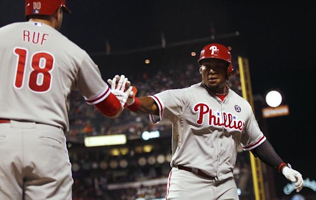 Philadelphia Phillies' Marlon Byrd, right, is congratulated by Darian Ruf after Byrd hit a home run during the fifth inning of a baseball game against the San Francisco Giants, Friday, Aug. 15, 2014, in San Francisco. (AP Photo/Beck Diefenbach)